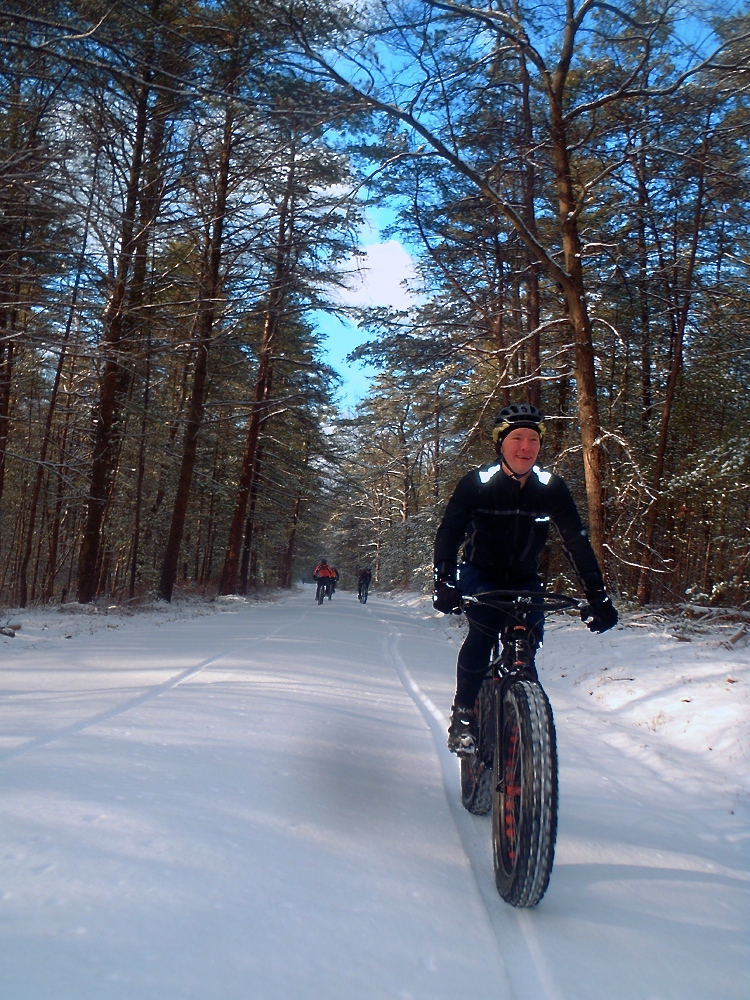 Riding bikes in the snow results in smiles! Photo: Evan Gross